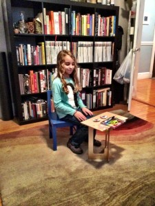 Kid Playing with StandStand Standing Desk