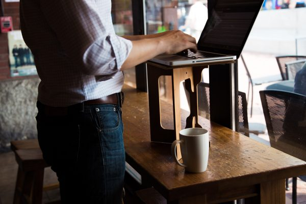 Portable standing desk at cafe