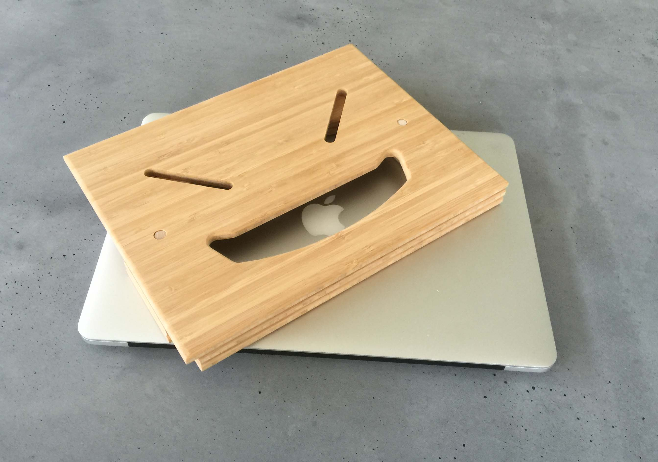 Folded standing desk with mac laptop